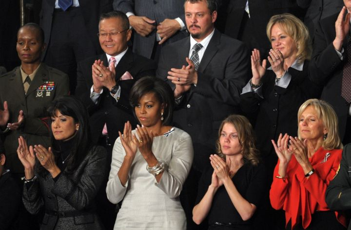 US First Lady Michelle Obama applaudes d