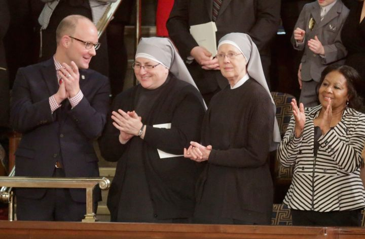 Two nuns from The Little Sisters of the Poor arrive clap for the president upon his arrival. The sisters were invited by Speaker of the House Paul Ryan (R-Wis.)