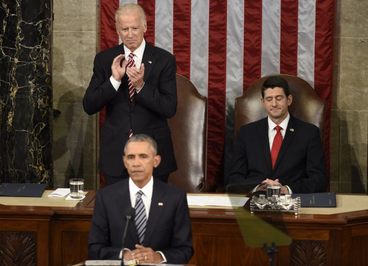 Always in president's corner, Joe Biden gives Obama a standing ovation at his final State of the Union address.