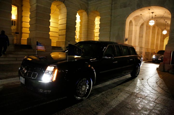 President Barack Obama arrives in the presidential limo on Capitol Hill for the final State of the Union address.