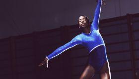 Female gymnast (13-15) doing floor exercise