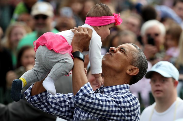 President Obama Greets A Baby At The 2016 White House Easter Egg Roll.