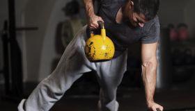Man training in crossfit gym