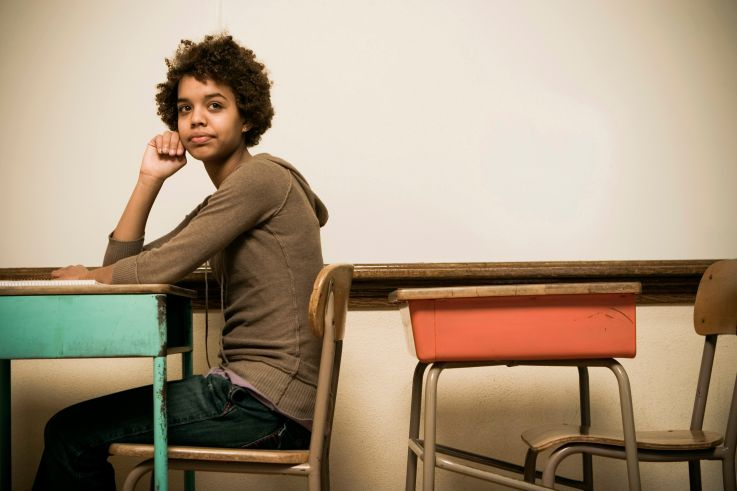 Student sitting at a desk in a classroom
