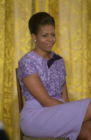 First lady Michelle Obama speaks in the East Room of the...