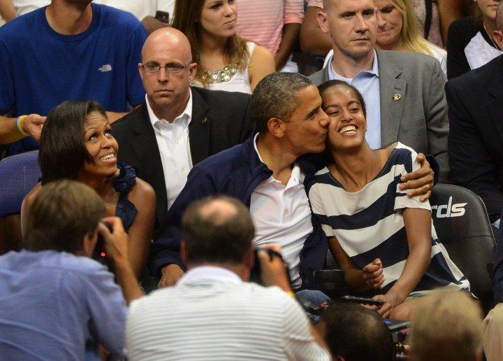 Barack Gives Daughter Malia a Kiss