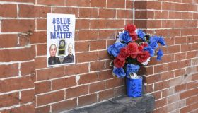 Blue Lives Matter poster on brick wall at site where...