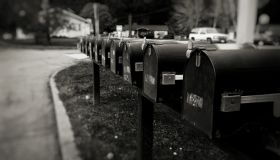 Close-Up Of Mailboxes By Street