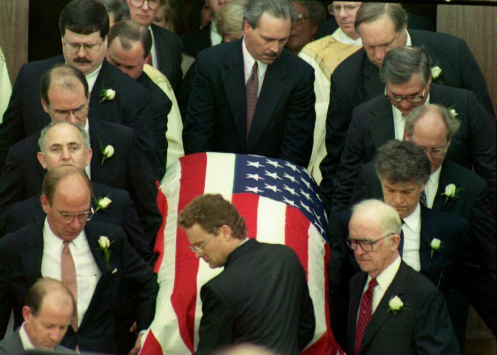 Pallbearers remove the casket of deputy White Hous