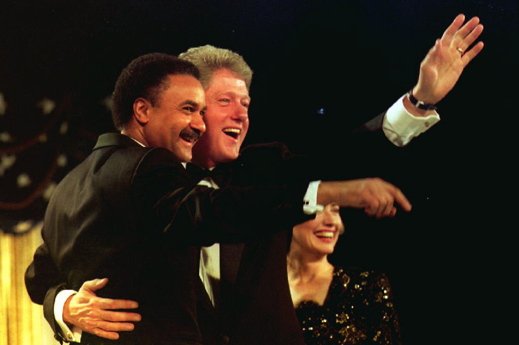 U.S. President-elect Bill Clinton (C) hugs Democra
