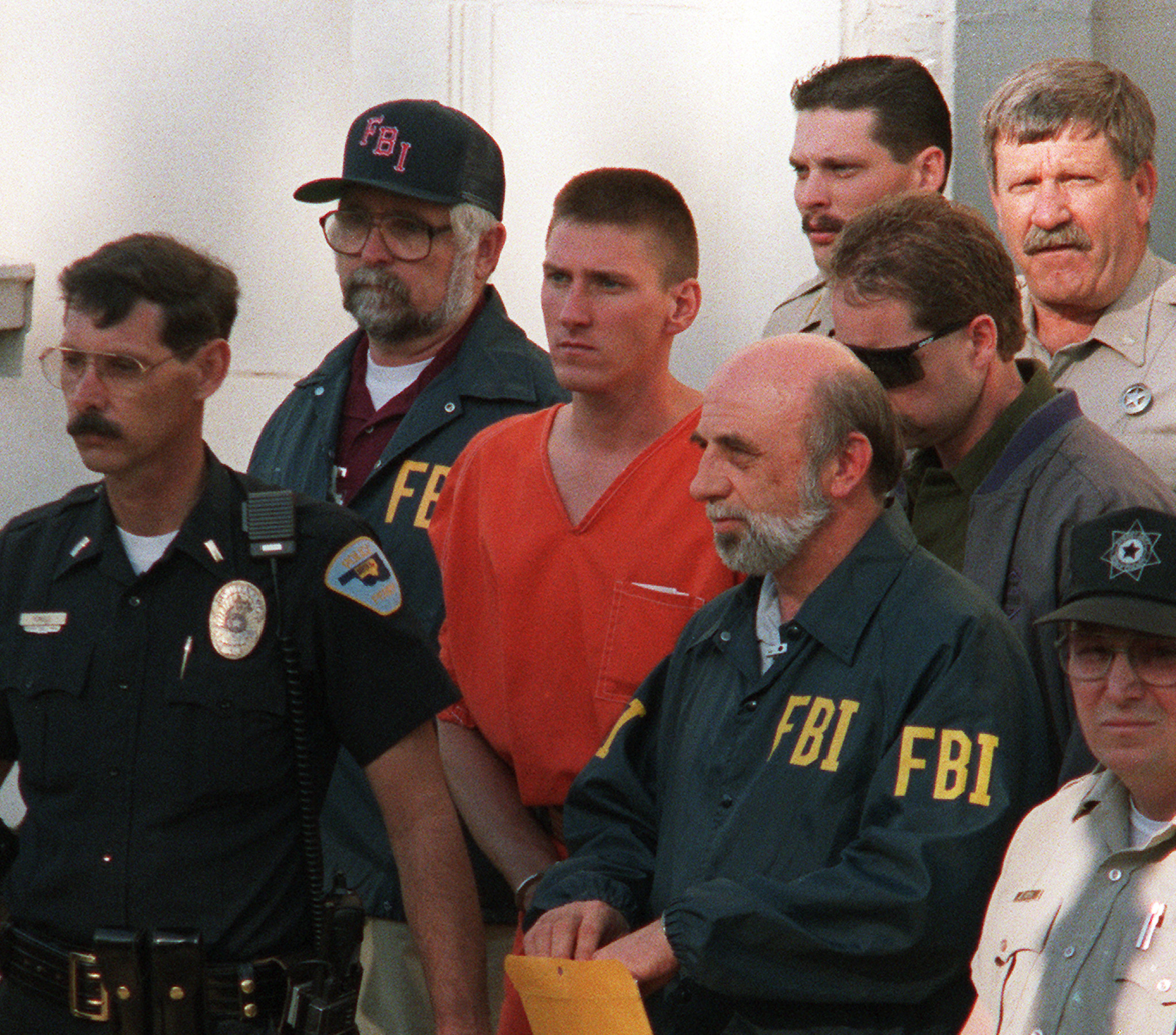 Timothy McVeigh, 27, (C) is led 21 April 1995 from