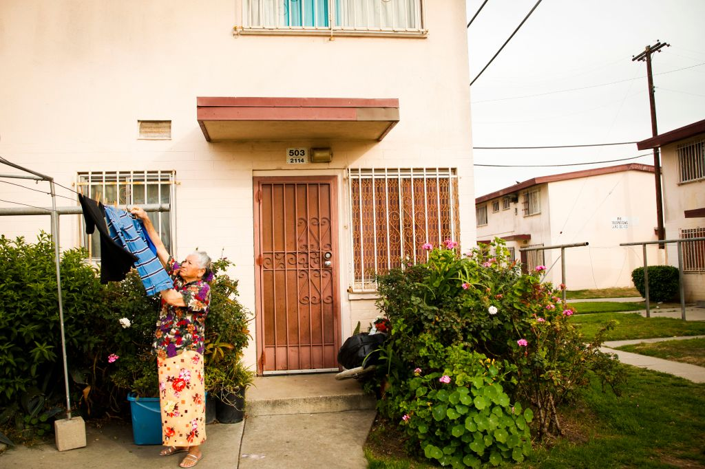 LOS ANGELES, CA FEBRUARY 15, 2013: A resident (declined to give her name) hangs laundry outside of