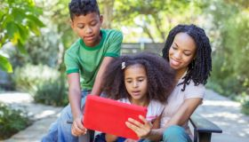 Family Reading Outside