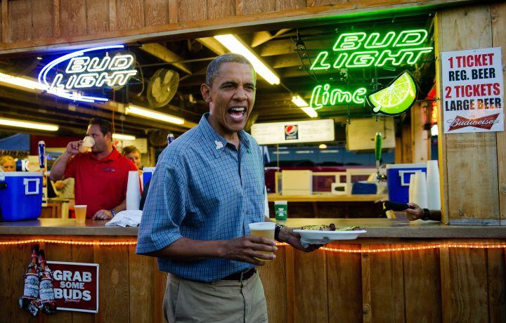 US President Barack Obama (C) gets a bee
