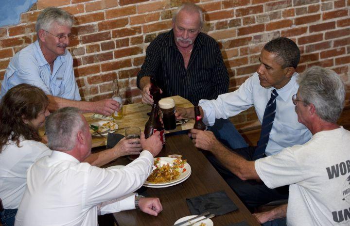 US President Barack Obama (2nd R) clinks