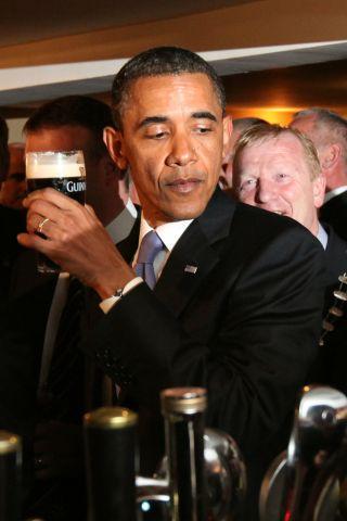 US President Barack Obama reacts after t