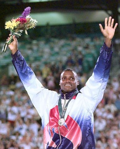 Carl Lewis of the US waves from the podium after r
