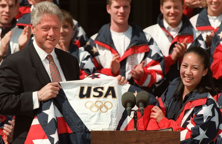 US President Bill Clinton(L) accepts a US Olympic
