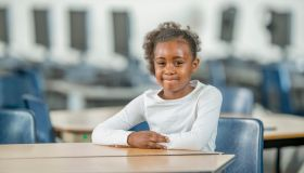 Young Student Sitting at Her Desk