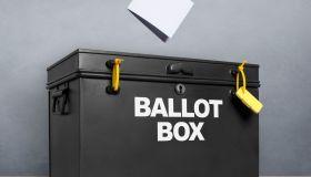 Ballot paper poised above the ballot box