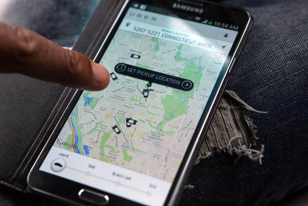 WASHINGTON, DC - APR 4: UberX driver, Michael Belet, checks th