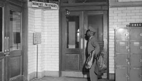 African American Soldier Reads Segregated Terminal Sign