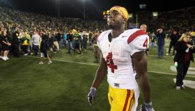 EUGENE, OREGON OCTOBER 31, 2009–USC's Joe McKnight walks off the field as fans celebrate the Oregon