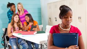 Teenage girls cyber-bully classmate using wireless technology.