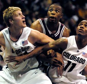 BOULDER, CO (JANUARY 13, 2007) -- Buffs Sean Kowal, left, (41) and Dominque Coleman, right, (11) tried to box out Aggie forward Joseph Jones on a rebound from a free-throw in the first half Saturday evening. The Colorado Buffaloes hosted the Aggies of Tex