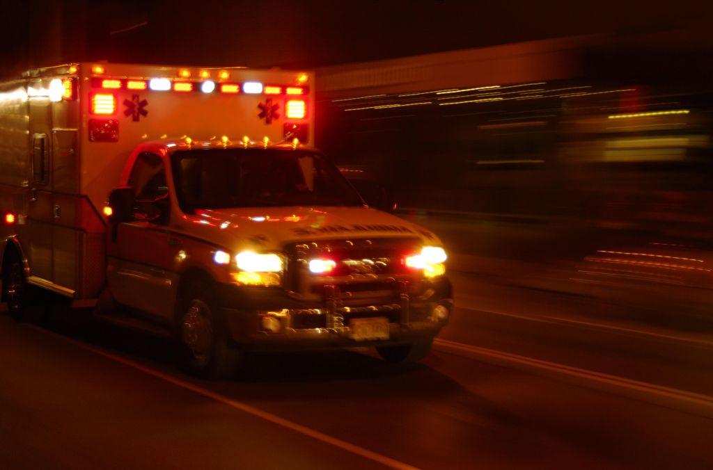Ambulance at night, speeding