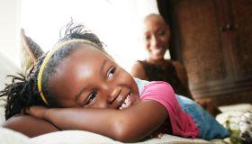 Black girl laying on sofa
