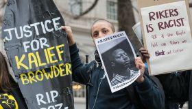 Demonstrators hold aloft a symbolic coffin bearing Kalief...