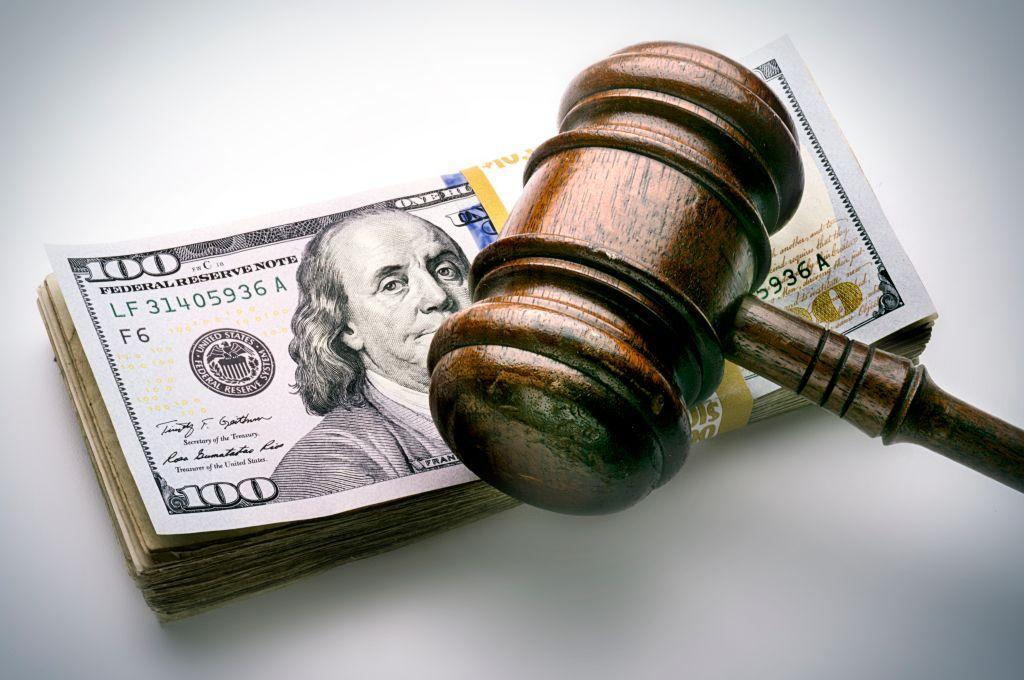 judge's gavel on money