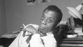 James Baldwin Sitting Smoking A Cigarette