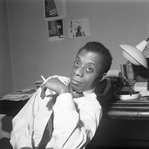 James Baldwin Sitting Smoking A Cigarette
