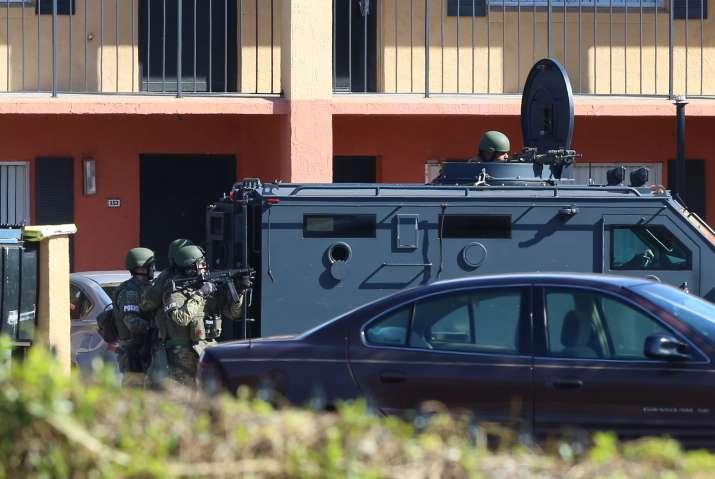 Orlando police officer shot and killed; deputy dies in crash during manunt for suspect