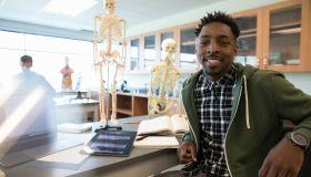Portrait confident male college student in anatomy laboratory classroom