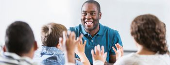 African American teacher and children in classroom