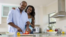 African middle class couple in the kitchen