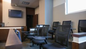 Jury box seats in empty courtroom