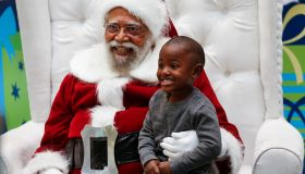 Jahleel Logan, 3, poses with Santa, a.k.a. Langston Patterson, 77, of Rudolph Holiday Photo, at the