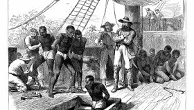 Captives being brought aboard a slave ship