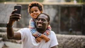 Father and son making selfie.