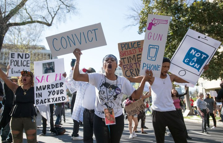 Activists Crowd The Block