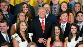 Trump Poses With Outgoing Interns