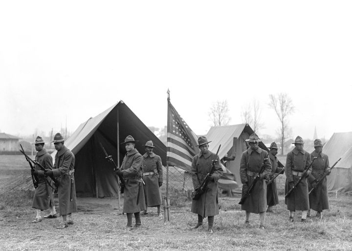 African-American Troops, Portrait Near Tents and American Flag, circa 1917