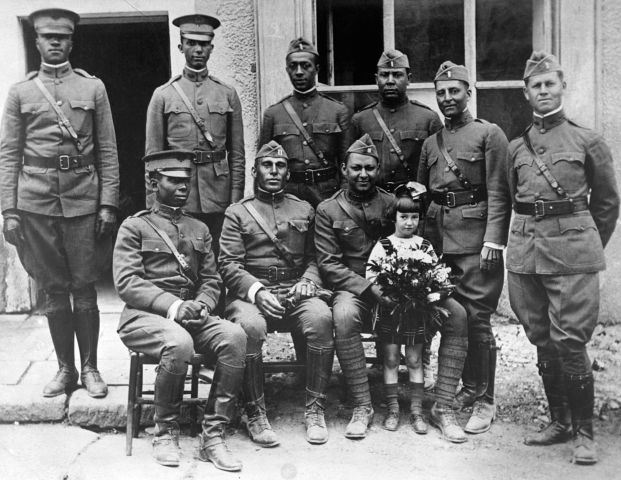American Officers Pose With Young Girl
