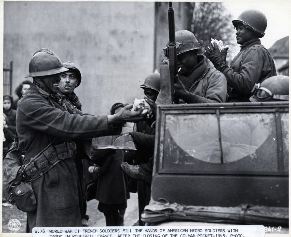 World War Ii French Soldiers Give Candy