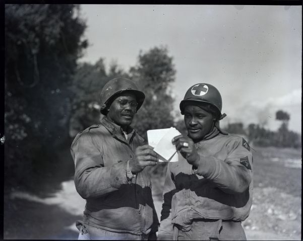 Soldiers Sharing Letter