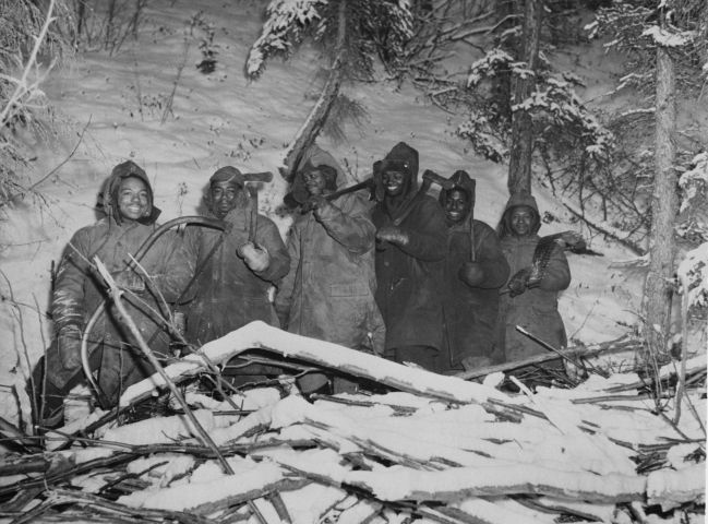 African American Soldiers Cutting Wood During World War II